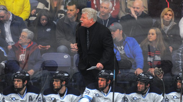 University of Maine hockey head coach Red Gendron yells instructions to his team during a game against Merrimack College on March 8 at Alfond Arena in Orono.