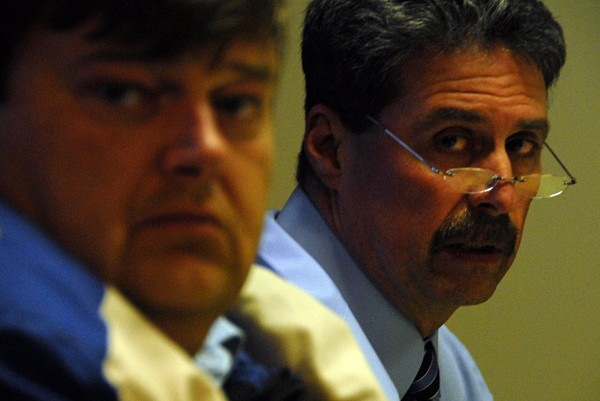 Lincoln Town Council Chairman Steve Clay listens and Town Manager William Lawrence speaks during a council meeting on Monday.