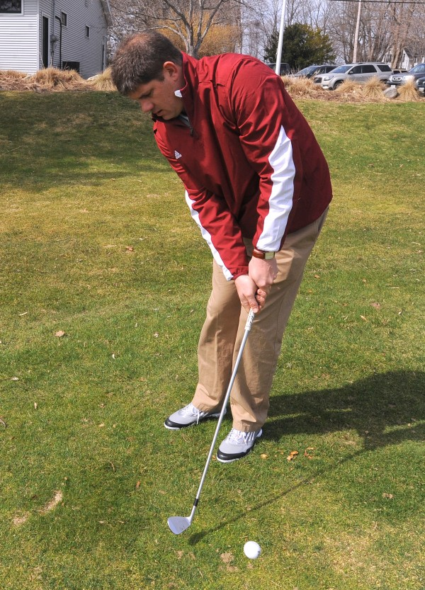 Rob Jarvis, assistant pro at Bangor Municipal Golf Course, demonstrates the use of the pitching wedge.