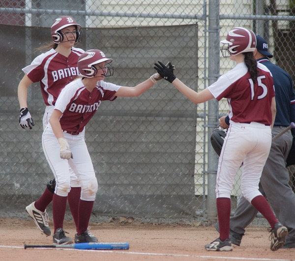 Bangor's Lexie Stanhope (left) and Cordelia Stewart (far left) get congratulations from teammate Sklylar Cassum (15) on two runs scored in the third  inning of their game against the Brewer Witches in Bangor, Maine, Friday, May 23, 2014.