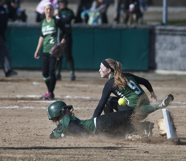Mount Desert Island's Darcy Kanu (5) slides into second base as the ball and the base get away from Old Town shortstop Mikayla Richards (9) in the second inning of their game in Old Town on Monday.