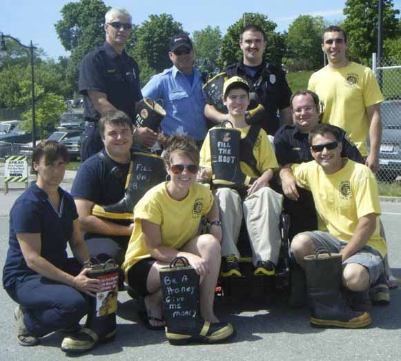 Adam MacDonald of Presque Isle (second row, second from left) is joined by Bangor firefighters for the MDA Fill the Boot campaign in 2012. Shown during the campaign are (first row, from left) Pamela Small, Lacie Willett, Ryan Blanchette, (second row) firefighter Cory Wyman, MacDonald, Ben Money, (back row) Jeff Sennett, Chuck Rodway, Dale Wunder and David Rudolph.