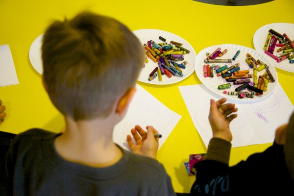 Children use crayons to draw at Little Angels Day Care and Preschool Wednesday afternoon in Bangor.