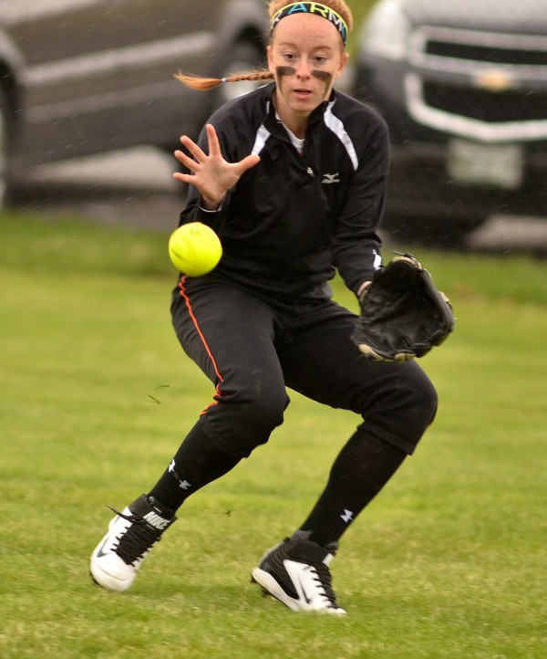 Skowhegan right fielder Renee Wright keeps the ball in front of her while fielding the ball against Brewer Friday in Skowhegan.