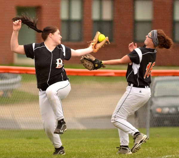 Brewer's third baseman Alexis Getchell (left) snags a flag ball while shortshop Mackenzie McCurdy backs her up in Skowhegan on Friday.