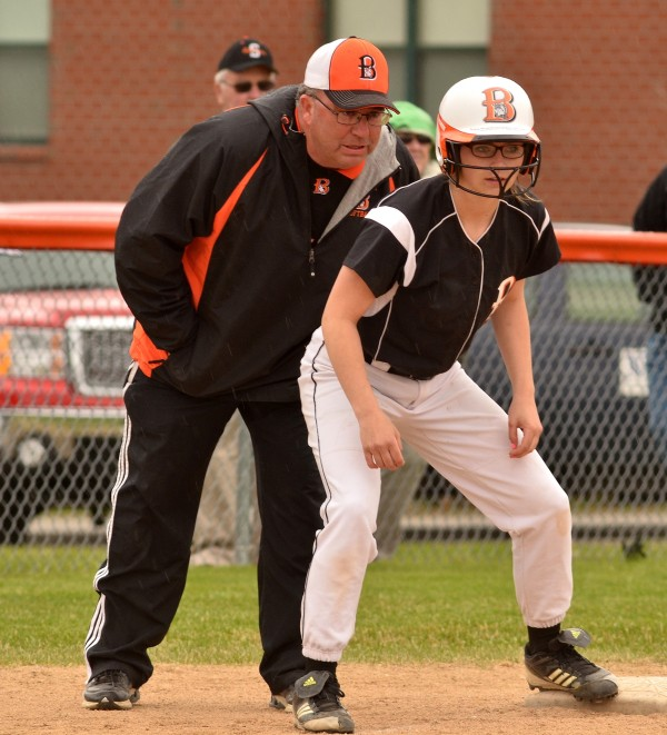 Brewer Head Coach Skip Estes (left) gives Cassy Green running instruction at third base while playing in Skowhegan Friday.