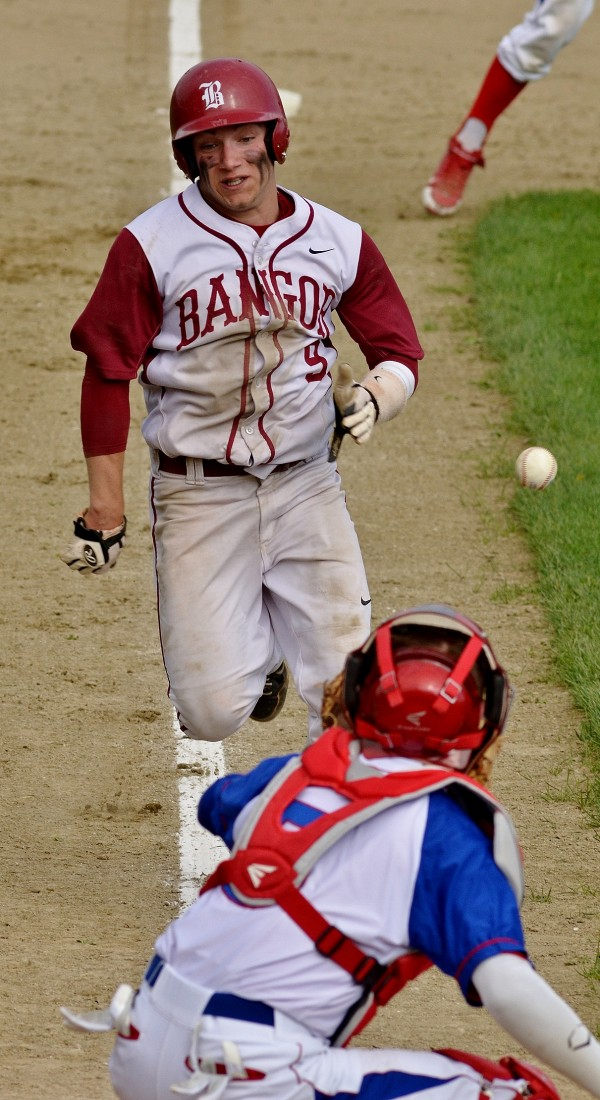 Bangor High School runner Andrew Hillier (top) is forced out at home by a throw to Messalonskee High School catcher Trevor Gettig Wednesday in Oakland.