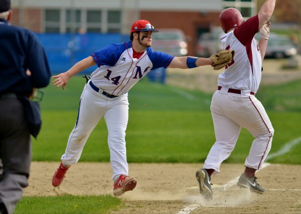 Bangor High School runner Brendan Moore (right) is called safe at first after Messalonskee High School's Connor Garland appears to make the tag Wednesday in Oakland.