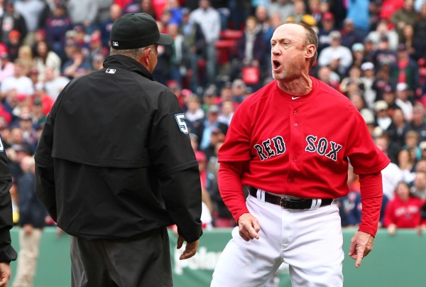 Boston Red Sox third base coach Brian Butterfield argues a call with umpire Dale Scott during the seventh inning against the Tampa Bay Rays at Fenway Park. Butterfield was ejected and the Red Sox went on to lose 2-1.