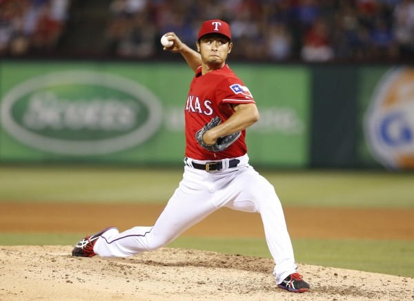 Texas Rangers starting pitcher Yu Darvish (11) throws in the seventh inning against the Boston Red Sox at  Global Life Park in Arlington, Texas, Friday night.