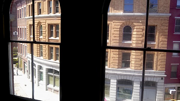 The historic Merchants Bank Buildings seen through the windows of the long-vacant Dakin building on Broad Street in downtown Bangor.