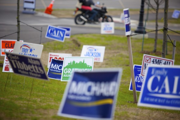Democratic campaign signs line the lawn at the Cross Insurance Center Friday afternoon for the start of the Maine Democratic Convention in Bangor.