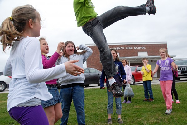 Opal Myrick Elementary School students toss 8-year-old Mason McDunnah in the air while playing in front of Schenck High School, where Opal Myrick has a wing for its elementary students. Opal Myrick received an A grade while Schenck received a C.