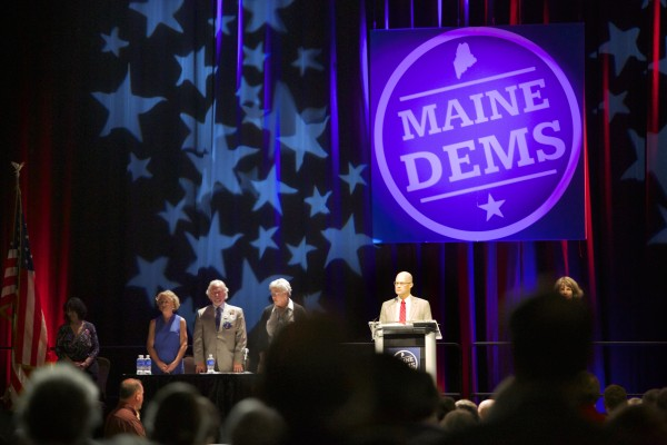 Ben Grant (right), chairman of the Maine Democratic Party, speaks at the start of the 2014 Maine Democratic Convention at the Cross Insurance Center in Bangor Friday afternoon.