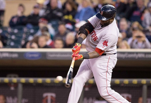 Boston Red Sox designated hitter David Ortiz (34) hits a home run in the fifth inning against the Minnesota Twins at Target Field Wednesday night.