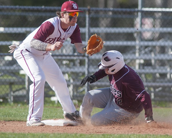 Bangor baseball player Sam Huston (left) waits for the throw as Edward Little player Brandan Varney slides into third on a steal in the third inning of their game at Mansfield Stadium in Bangor, Maine, on Tuesday.