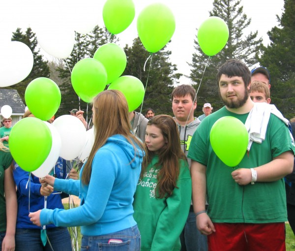 Brandon Higgins, at right holding a balloon, attends a pep rally held in his honor Wednesday at Deer Isle-Stonington High School. Higgins, who is 18 and lives in Brooklin, has brain cancer.