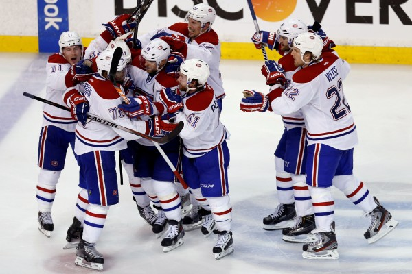 Montreal Canadiens defenseman P.K. Subban (76) is swarmed by teammates after scoring a goal in the second overtime period against the Boston Bruins in game one of the second round of the 2014 Stanley Cup Playoffs at TD Banknorth Garden in Boston Thursday night.  The Canadiens won 4-3.