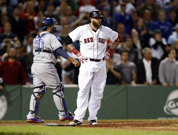 Boston's Jonny Gomes (5) reacts after striking out against the Toronto Blue Jays during the ninth inning at Fenway Park in Boston Wednesday night.
