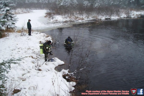 Maine Warden Service divers search Umbazooksus Stream for missing Canadian man, Renald Poulin, in December 2013.