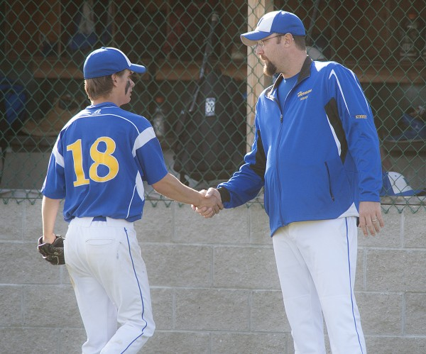 Hermon pitcher Nick Guerette, 18, gets a congratulation from coach Matt Kinney in the fifth inning of their game against Ellsworth in Hermon Thursday.