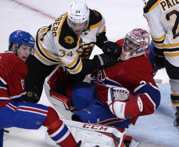 Boston Bruins forward Carl Soderberg (34) collides with Montreal Canadiens goalie Carey Price (31) during the third period of Game 3 ib the second round of the 2014 Stanley Cup Playoffs at the Bell Centre in Montreal.