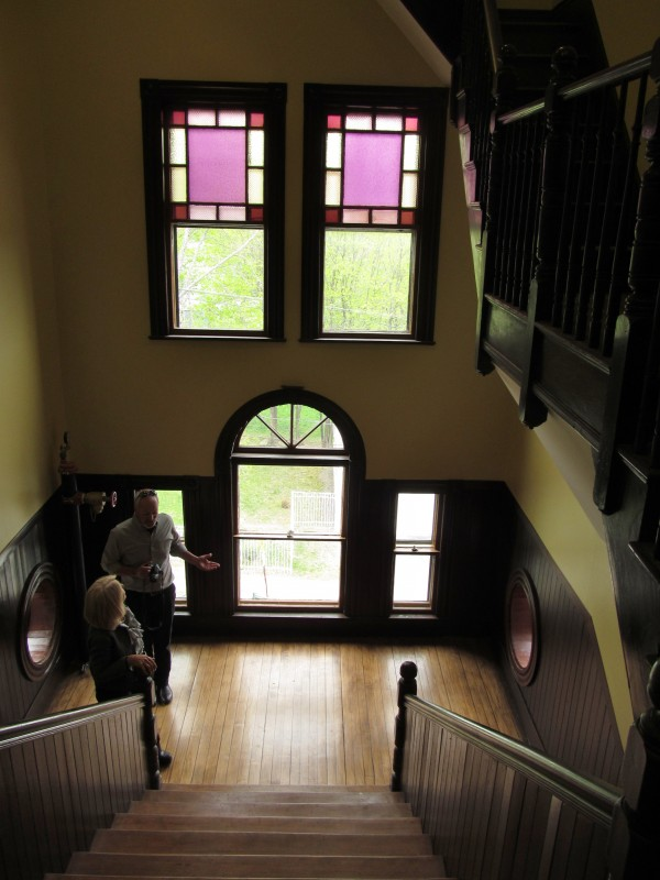 People tour the former St. Hyacinth School in Westbrook, which developers Avesta Housing and Kevin Bunker have partnered to convert into part of a 37-unit housing complex. Avesta held a ceremonial grand opening for the project late Friday afternoon.