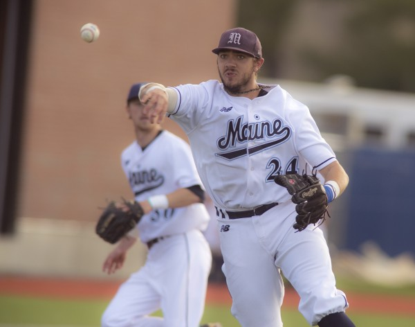 UMaine's Luke Morrill (24) snaps a ground ball and throws to first base in the fifth inning in the first game of a doubleheader against UMBC at  Mahaney Diamond in Orono on Friday.