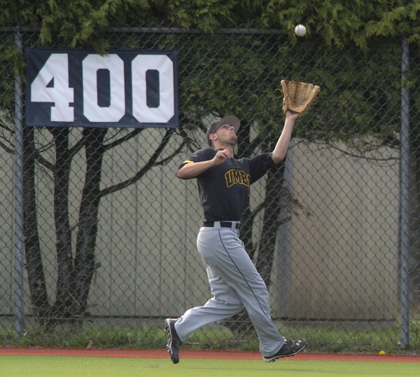 UMBC center fielder Rob McCabe makes a catch at the fence in the fourth inning in the first game of a doubleheader against UMaine at Mahaney Diamond in Orono on Friday.