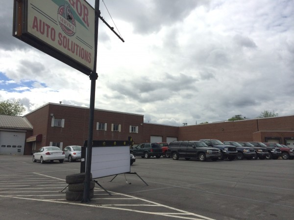 There are about 19 vehicles not inspected and parked in the Bangor Car Solutions lot on Washington Street on Thursday.