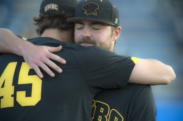 Senior pitcher Mac Gill (right) gets a hug from teammate and fellow senior Stephen Chrzanowski (45) after his last pitch in his last game as a UMBC player in a game against Maine at Mahaney Diamond in Orono on Maine Friday.