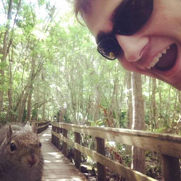 An Auburn teen is flustered but unharmed after a photo op with a squirrel went awry in Florida.