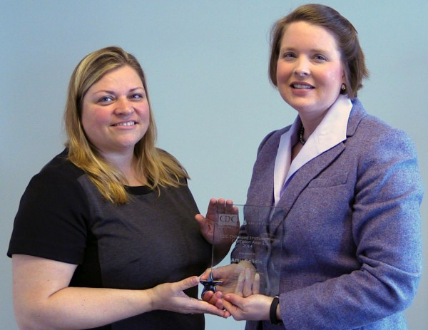 (L-R) Tonya Philbrick of the Maine Immunization Program presents award to Dr. Amy Belisle