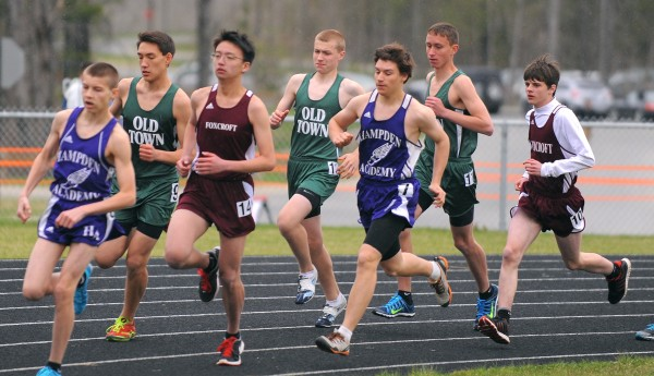 Connor Archer (center), a sophomore at Old Town High School, competes in the 1,600-meter run during a track and field meet in Hampden Friday.