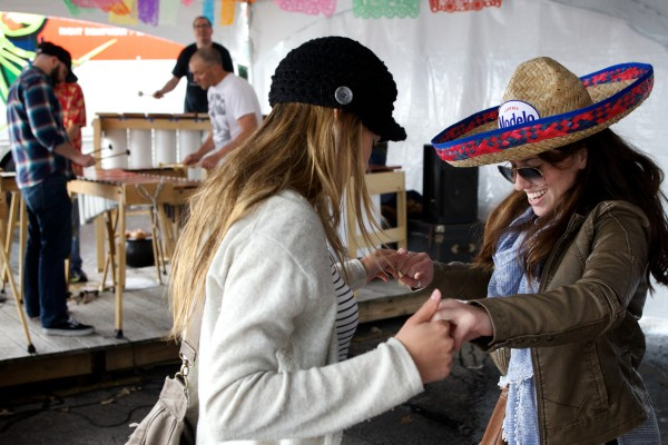 Josie Barth (left) and Abby Donnelly of Cape Elizabeth dance to the sounds of the Maine Marimba Ensemble at an early Cinco de Mayo celebration at El Rayo Taqueria in Portland on Sunday. Intermittent hail and rain showers did little to dampen the spirits of those on hand.