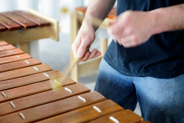 Mallets move in a blur as the Maine Marimba Ensemble plays dance music at El Rayo Taqueria in Portland on Sunday at an early Cinco de Mayo celebration on Sunday.