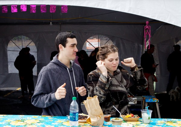 Chris Duffey and Alexa Bradt dance and enjoy the food at El Rayo Taqueria in Portland on Sunday afternoon in Portland at a Cinco de Mayo celebration. The unofficial holiday marks the victory of the Mexican army over the French at the battle of Puebla in 1862.