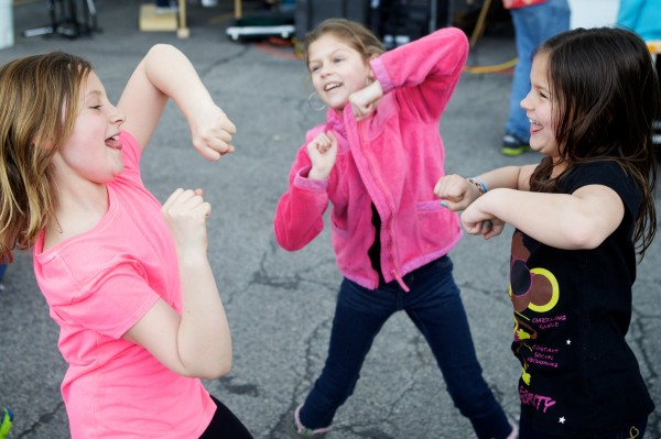 Katelyn Munro, 10, (from left) Madison Marquis, 10, and Elise Marquis, 8, dance to the music of the Maine Marimba Ensemble at El Rayo Taqueria in Portland on Sunday during an early Cinco de Mayo Celebration.