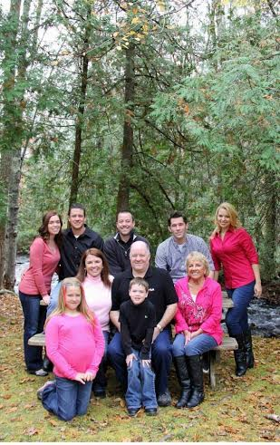 Cheryl Morrill (middle row, left) found that it takes a village to raise children when her sons were growing up. With Morrill are her grandchildren (front row, from left) Mara Jade and Chase; (middle row, from left, sitting beside Cheryl) David Morrill and Cat Hanley, who is Cheryl's mother; and (back row, from left) Jenny and Gregg Morrill, David Morrill II, Zack Adams and Becky Young.