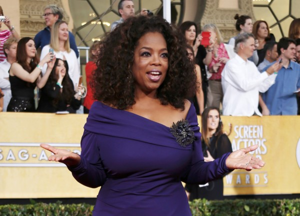 Actress Oprah Winfrey from the film &quotThe Butler&quot arrives at the 20th annual Screen Actors Guild Awards in Los Angeles, California, Jan. 18, 2014.