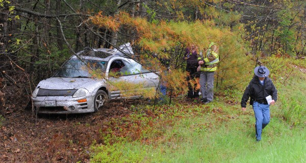 A car slid off the northbound lane of I-95 in Hampden Monday. The vehicle appeared to have spun around and hit a group of trees with its rear end. At least one person was injured in the accident.