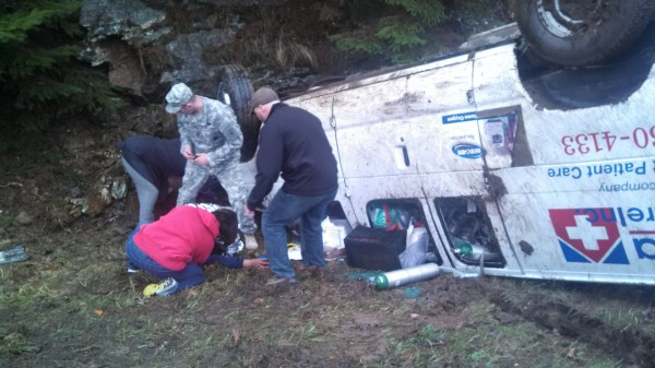 A victim is tended to by passers-by after a van crashed on Interstate 95 on Thursday morning.