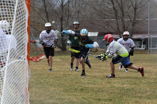 Grant Kidon scores for the EMYL 7th-8th &quotwhite&quot team against Mid Maine.
