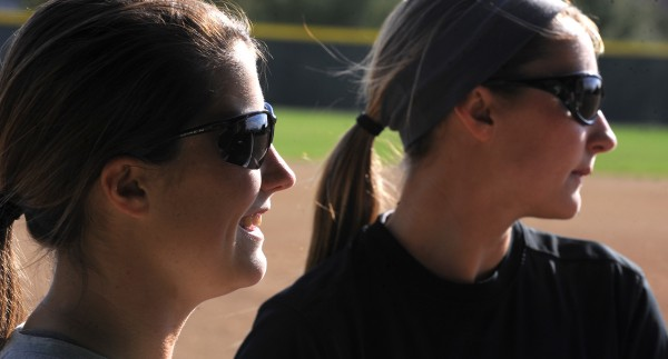 Lyndsay Merrill (left) and her sister Kayla Merrill are both on the Husson University softball team.