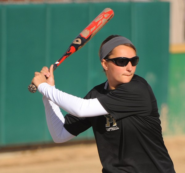 Kayla Merrill pitches and plays third base on the Husson University softball team and has helped lead the Eagles to an NCAA Tourney berth.