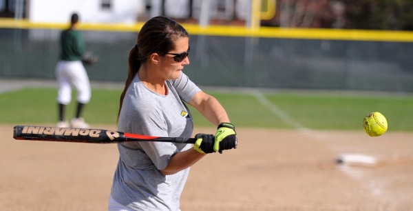 Husson's Lyndsay Merrill takes batting practice in Bangor Tuesday as the team prepares for the NCAA Tourney.