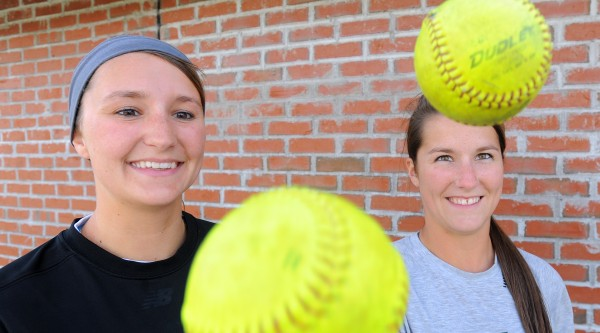 Kayla Merrill (left) and her sister Lyndsay Merrill are both on the Husson University softball team.
