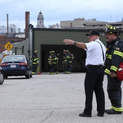 Portland Deputy Fire Chief David Jackson and Capt. Mike Kucsma discuss a gas leak at the intersection of Kennebec Street, Marginal Way and Forest Avenue on Monday morning.