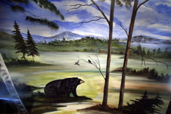 A black bear traveled through a Maine scene depicted in the mural inside the teepee.