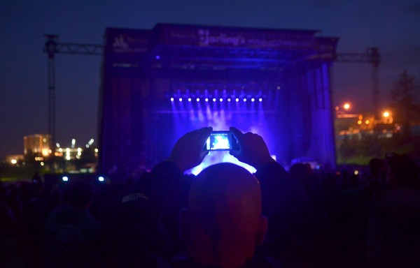 Cellphones flicker as Seether performs in the Rise Above Fest Saturday in Bangor.